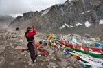 4.	Pute, 42  Thrilled at having arrived at the pass, Pute tied a string of prayer flags to the Drolma stone and proceeded to prostrate in the frigid wind for a half hour or more.
